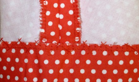 polka dot top, catch stitching