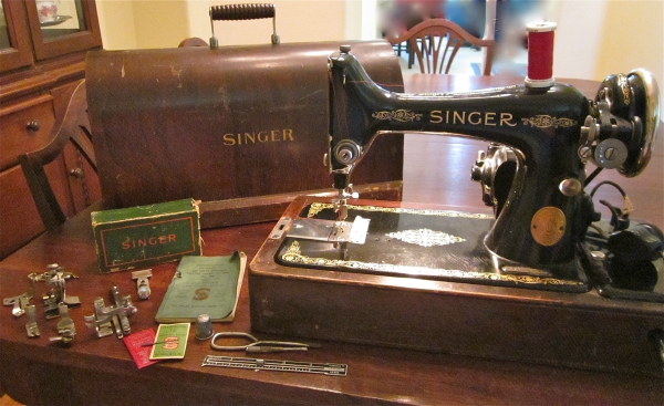 This is a Singer 99 sewing machine, built in February 1924 with a ton of accessories!
