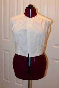 Here is the original muslin. You can see the gap at the front edges, which means the center fronts are even further apart. And I keep the waist set at smaller than my own waist, otherwise waistbands that fit me won't fit it.