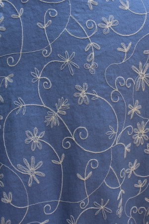I thought this blue linen with cream embroidery would make a pretty top.