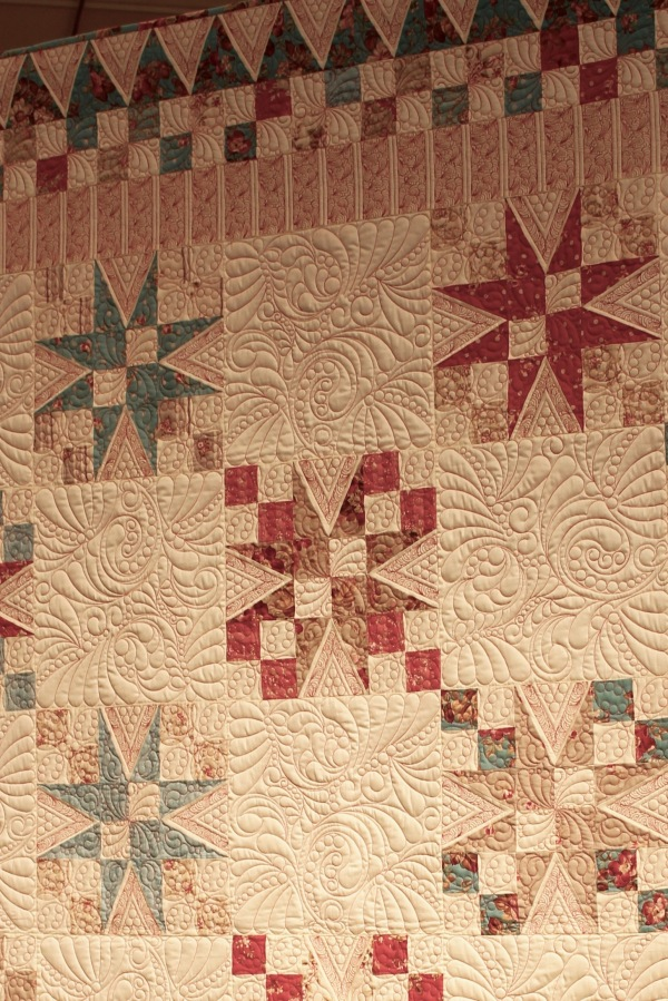 Fantastic quilt. The red quilt stitches really enhance this beautiful quilt.