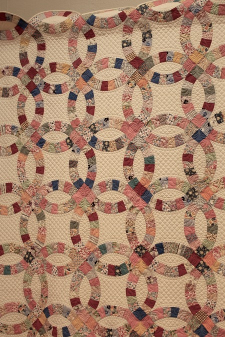 I believe this is Grandmas' Endless Love by Gina Heon. I have always been fascinated by double wedding ring quilts. The geometry of the pieces is crazy.